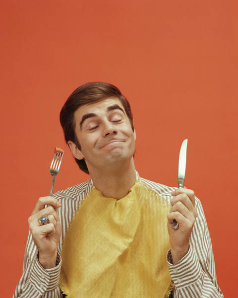 Content Photograph - Man Holds Up A Knife And Fork, 1960s by Archive Holdings Inc.