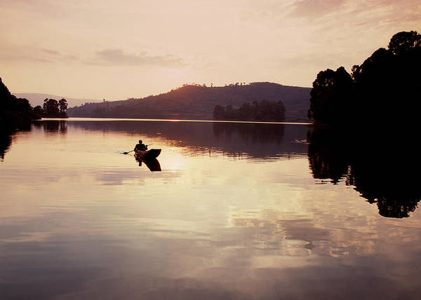 Canoe Photograph - Man In Canoe On African Lake by Harry Hook