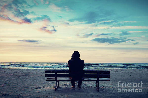 Wall Art - Photograph - Man In Hood Sitting On A Lonely Bench On The Beach by Michal Bednarek