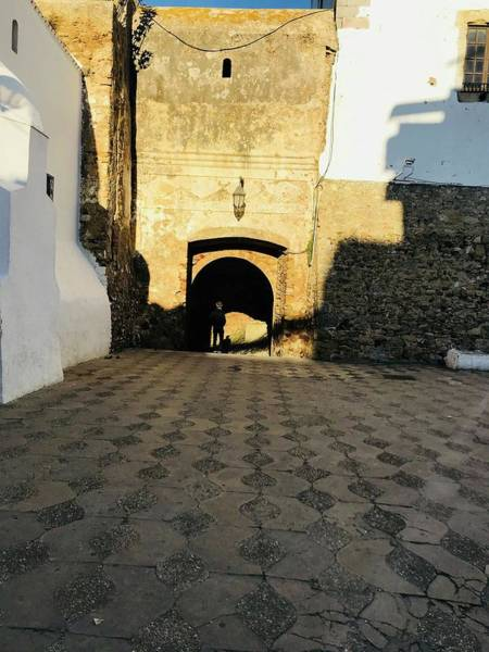 Asilah Wall Art - Photograph - Man In The Moroccan Arch by Winter Nicole Monroe