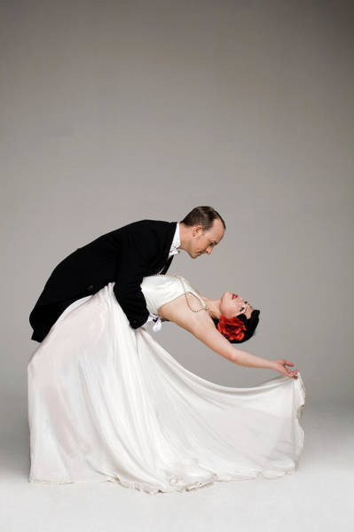 Bending Photograph - Man In Tuxedo Dipping Woman In White by Allison Michael Orenstein