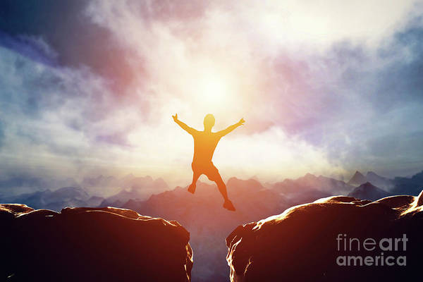 Photograph - Man Jumping Between Two Mountains At Sunset. by Michal Bednarek