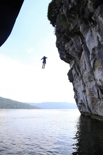 Photograph - Man Jumping Off A Cliff Into The Sea by Win-initiative