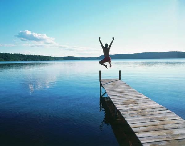 Man Jumping Off Jetty Into Lake, Rear Art Print
