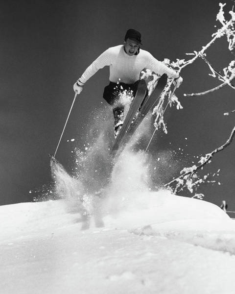 Alpine Skiing Photograph - Man Jumping Through Air On Skis by Stockbyte