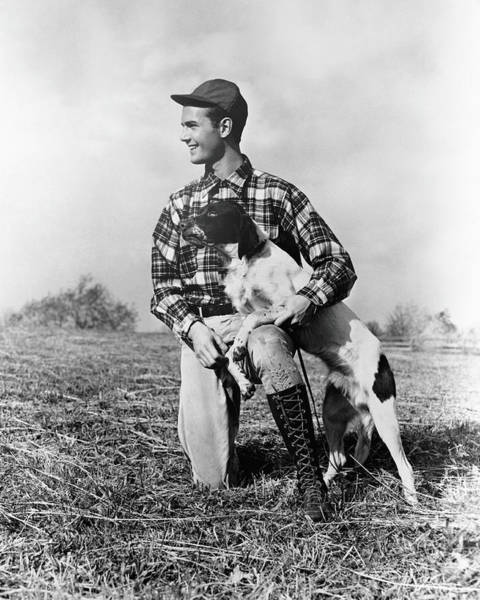 White Dog Photograph - Man Kneeling Down Next To Setter, Arm by H. Armstrong Roberts