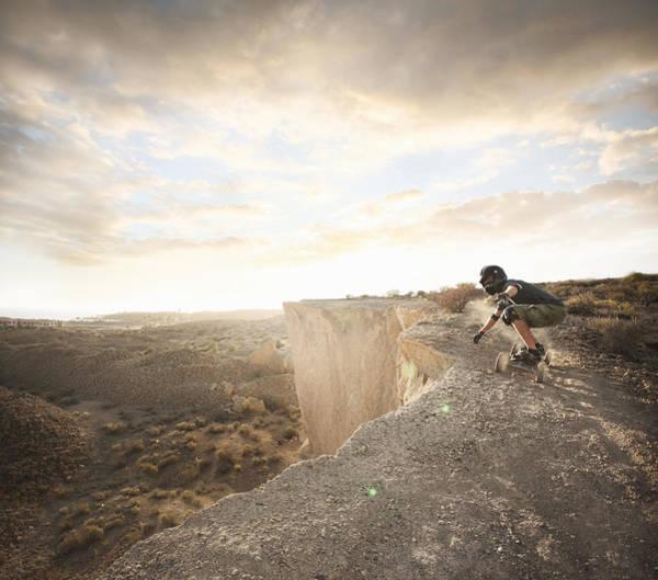 Skateboard Photograph - Man Landboarding On Rocks by Stanislaw Pytel