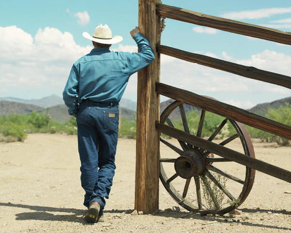 Ranch Photograph - Man Leaning Against Ranch Fence by John Slater