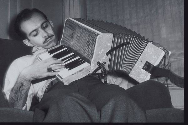 The Past Photograph - Man Leaning On Back, Playing Accordion by Archive Holdings Inc.