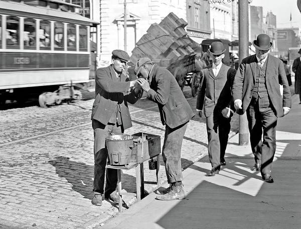 Painting - Man Lighting Cigarette For Another On City Street, 1900-10 by Celestial Images