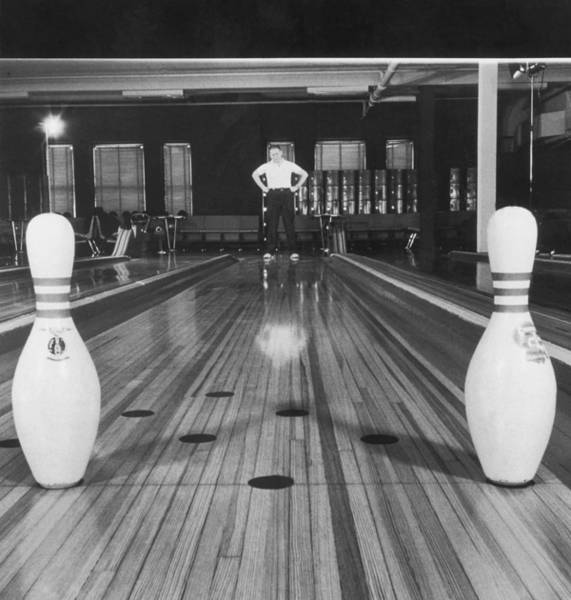 Bowling Alley Photograph - Man Looking At Bowling Pins Left by Fpg