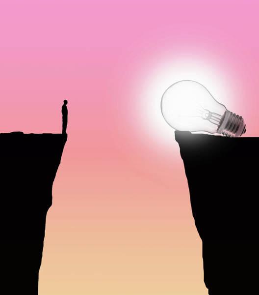Wall Art - Photograph - Man Looking At Glowing Light Bulb by Ikon Images