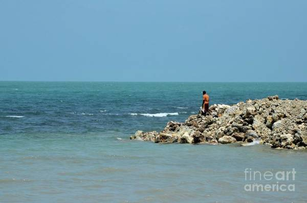 Photograph - Man On Rocks Looks Out To Ocean From Rocky Beach Jaffna Peninsula Sri Lanka by Imran Ahmed