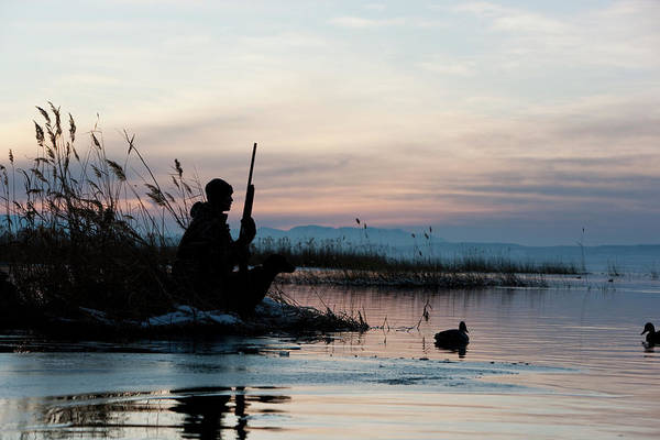 Rifle Photograph - Man Out Hunting by Rubberball Productions