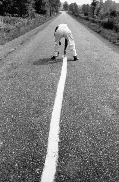 One Way Road Photograph - Man Painting Stripe Down Road In Black by Alfred Gescheidt