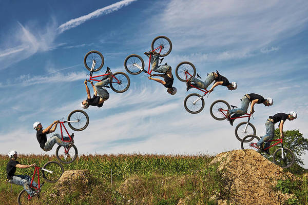 Bmx Photograph - Man Performing Stunt On Bmx Bike by Manuel Sulzer