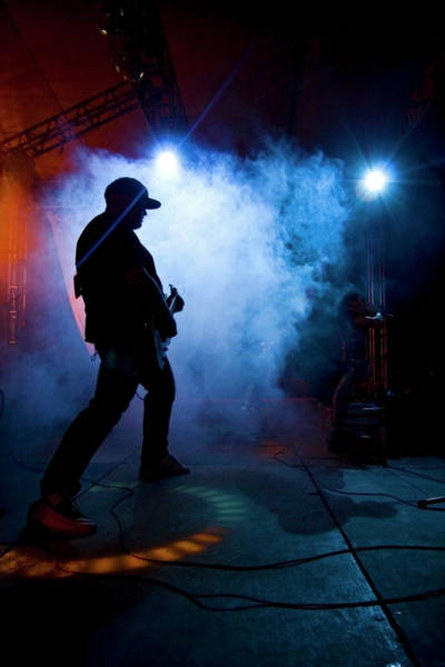 Concert Hall Photograph - Man Playing A Guitar In A Concert by Hans Neleman