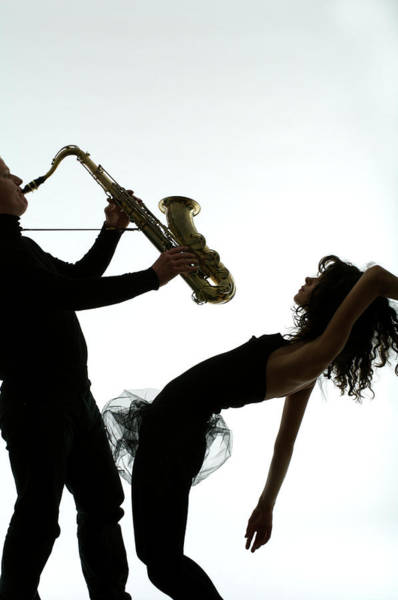 Wall Art - Photograph - Man Playing Saxophone, With Young Woman by Markus Amon
