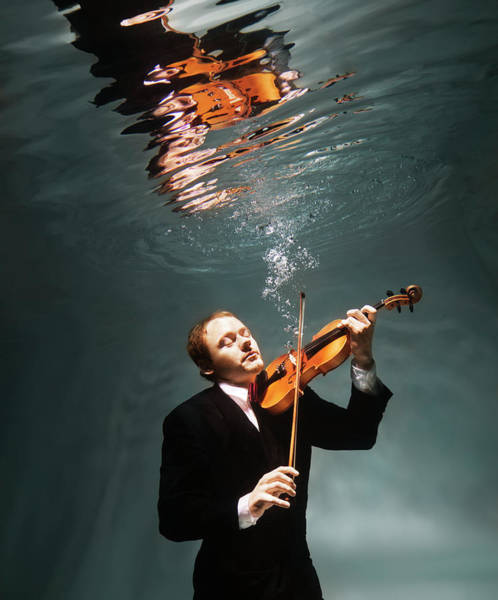 Underwater Photograph - Man Playing Violin Underwater by Henrik Sorensen