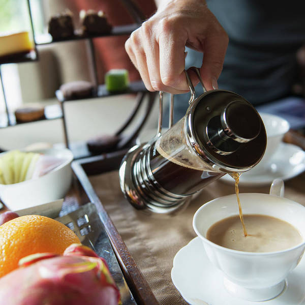 Wall Art - Photograph - Man Pouring Coffee Into A Cup From A by Keith Levit / Design Pics