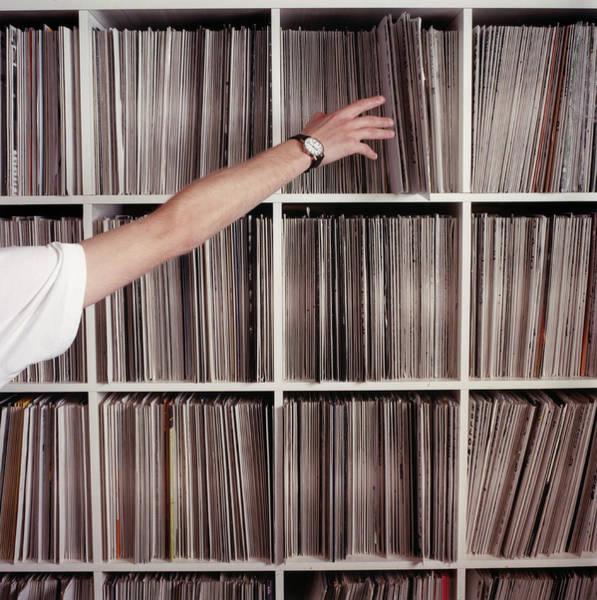 Wall Art - Photograph - Man Reaching For Record by Louis Debenham
