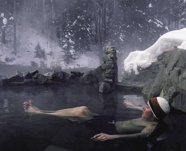 Steamboat Springs Photograph - Man Relaxing In Hot Springs Pool by Jason Dewey