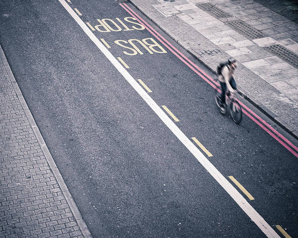 Bicycle Photograph - Man Rides A Bicycle In London by Cirano83