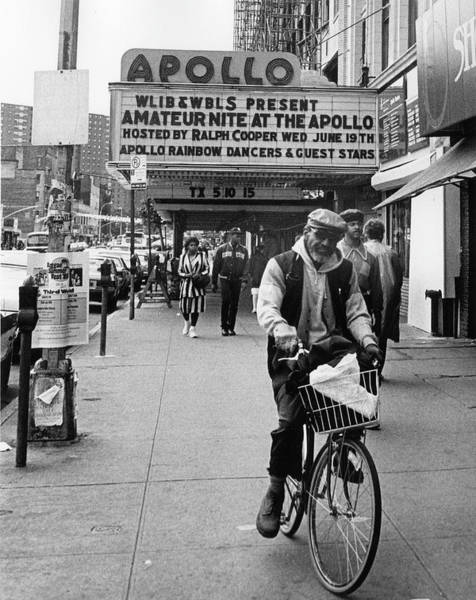 Apollo Theater Photograph - Man Rides Bike On Sidewalk In Front Of by The New York Historical Society