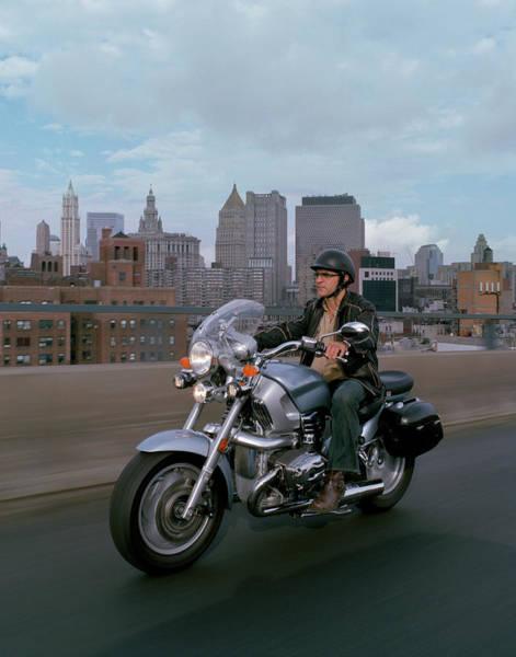 Crash Helmet Photograph - Man Riding A Motorcycle Across Brooklyn by Livia Corona