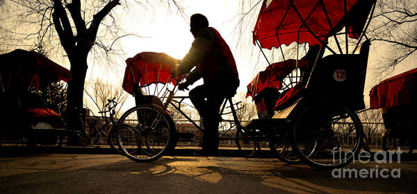 Man Riding A Rickshaw Art Print