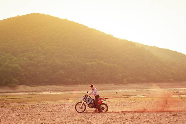 Dust Photograph - Man Riding Dirt-bike In Dress Shirt And by Greg Samborski
