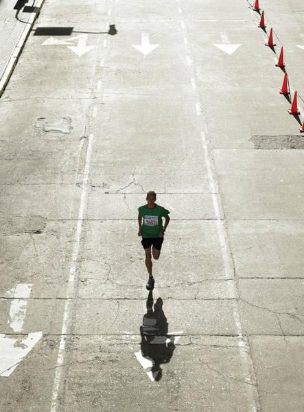Wall Art - Photograph - Man Running In Marathon On City Street by Michael Blann