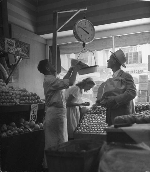 Merchandise Photograph - Man Shopping In Fruit Store.  Photo By by Nina Leen