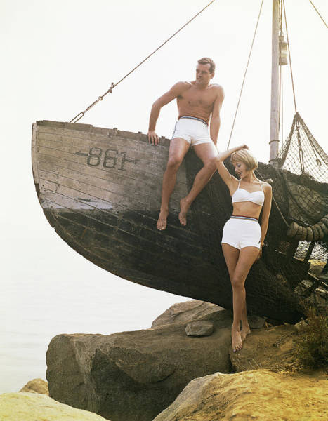 Hand Photograph - Man Sitting Boat, Woman Standing Beside by Tom Kelley Archive