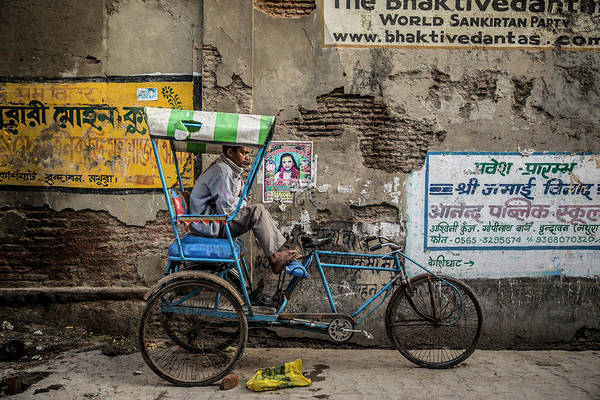 Wall Art - Photograph - Man Sitting In His Rickshaw Waiting For A Client by Ruben Vicente