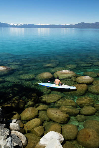 Wall Art - Photograph - Man Sitting On Paddleboard At Lake by Panoramic Images
