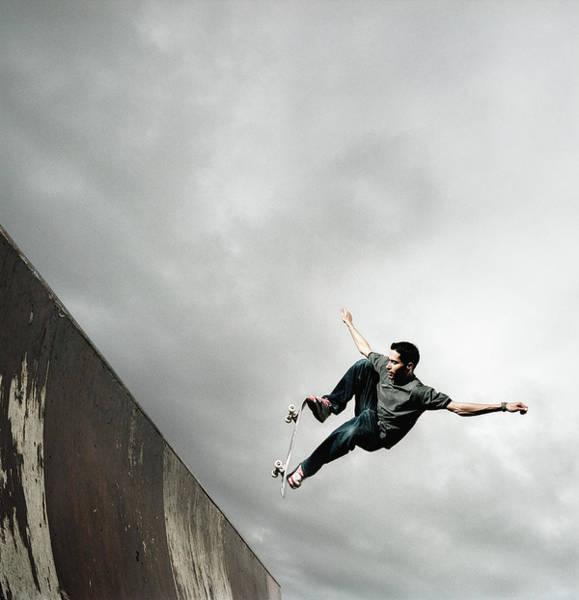 Skateboard Photograph - Man Skateboarding On Ramp by Stuart Mcclymont