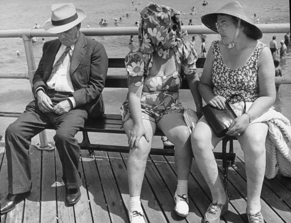 Atlantic City Photograph - Man Sleeping L While Two Women Sit On by Alfred Eisenstaedt