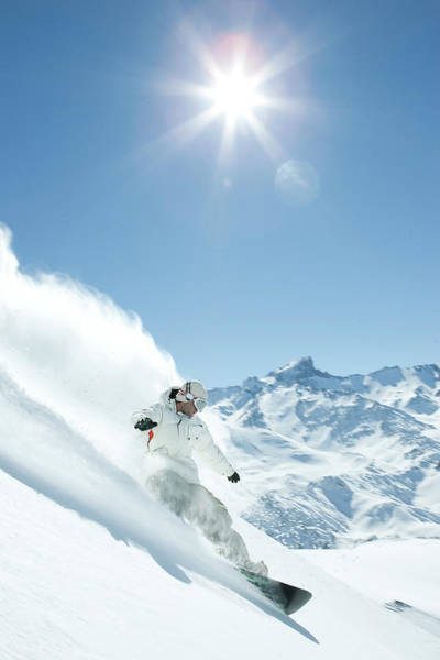 Photograph - Man Snowboarding Down Mountainside by Chad Riley