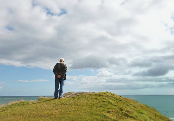 Gray Hair Photograph - Man Standing Alone On A Hill Staring At by Ken Welsh / Design Pics