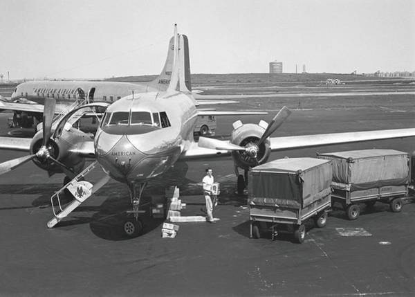 Land Mark Photograph - Man Standing At Airplane On Runway, B&w by George Marks
