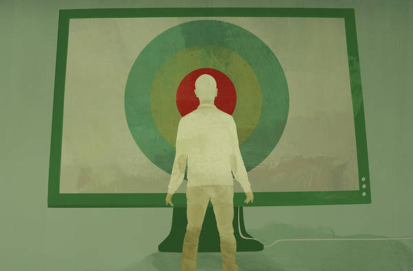 Wall Art - Photograph - Man Standing In Front Of Large Target by Ikon Images