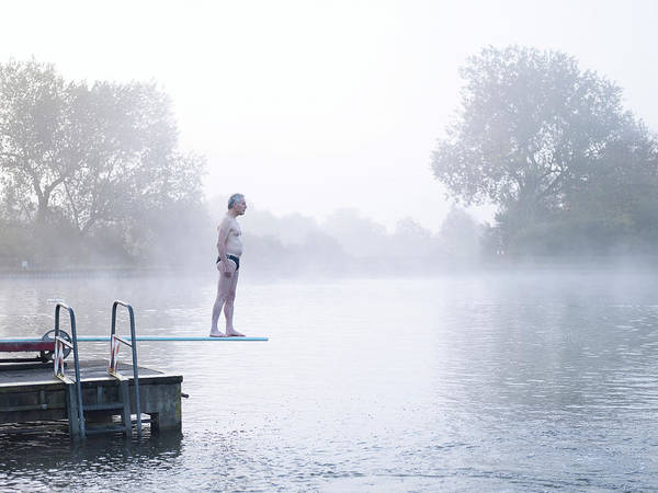 Plunge Photograph - Man Standing On Diving Board In Outdoor by Devon Strong