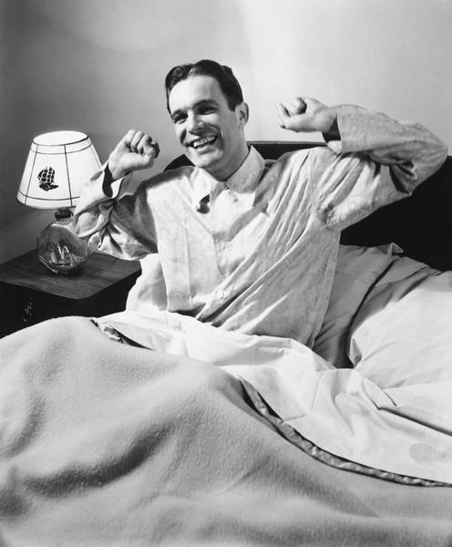 Gesturing Photograph - Man Stretching In Bed, B&w by George Marks