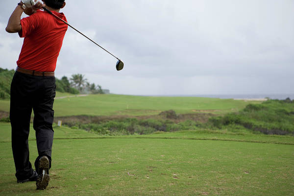Golf Photograph - Man Swinging Golf Club, Rear View by Flashfilm