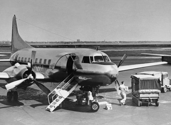 Stationary Photograph - Man Unloading Cargo From Plane by George Marks