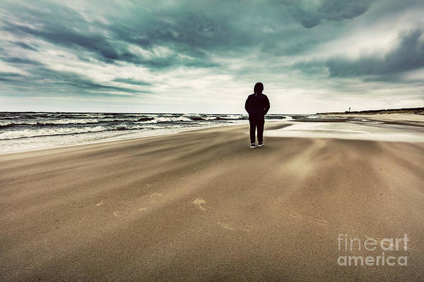 Wall Art - Photograph - Man Walking Alone On The Beach On Windy Stormy Day. by Michal Bednarek