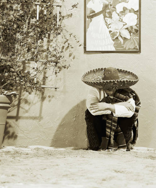 Traditional Clothing Photograph - Man Wearing Hat, Crouching By Wall by Lisa Peardon