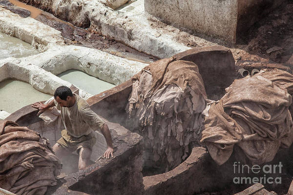 Wall Art - Photograph - Man Working At Tannery In Morocco by Patricia Hofmeester