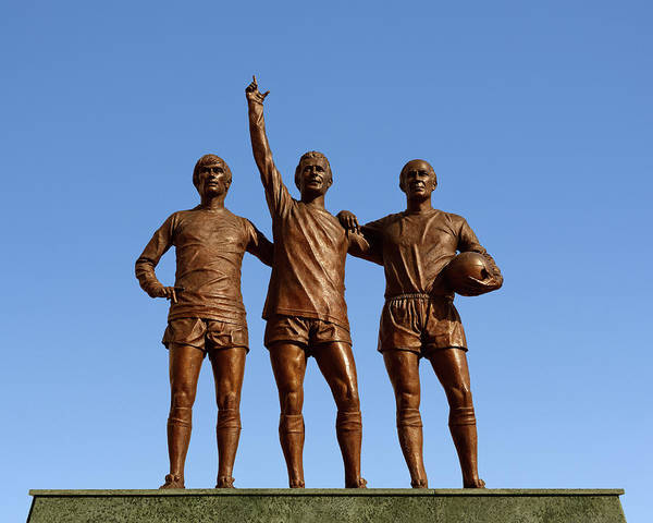 Greater Manchester Wall Art - Photograph - Manchester United Holy Trinity Statue Outside The Old Trafford Stadium Manchester England United by imageBROKER - Simon Belcher